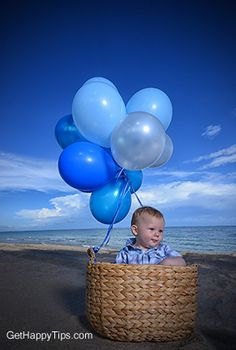 Baby and balloons on beach - cute photo idea for one year old birthday