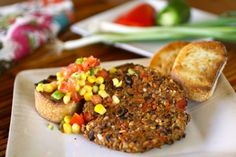 Black Bean Veggie Burgers with Corn Salsa - these are so yummy, made with mushrooms instead of breadcrumbs. chopping is time-consuming, but otherwise easy