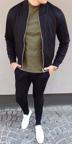 Men Clothing Minimal style inspiration with a black bomber jacket olive t shirt black denim with white sneakers in this street style look Men Clothing Source Urban Outfits, Mode Outfits, Fashion Outfits, Fashion Trends, Fashion Models, Stylish Mens Outfits, Casual Outfits, Men Casual, Casual Styles