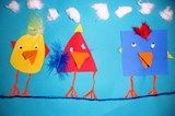 Primary Birds; First Graders reviewed geometric shapes and then chose three for their three birds. We used primary colors (red, yellow and blue) to make our birds. Students then were to use freeform/ organic shapes to create wings and feathers. Lastly we decorated with cotton balls for clouds, string for the line they are on and puffy feet.
