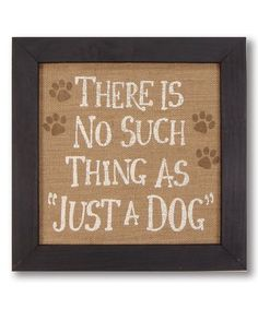 Dog lovers can adorn their home with this decorative wall sign that pays homage to four-legged friends.