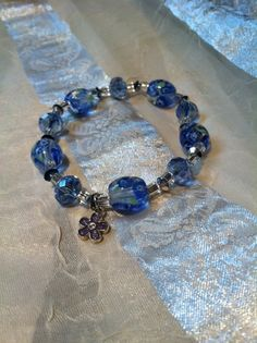 Charming Blue Flower Bracelet by NorthCoastCottage on Etsy, $15.00