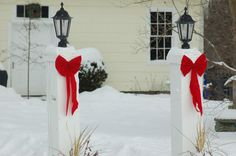 "New England Christmas scene using simple decorations. The symmetrical arrangement scheme is what makes this simplicity ""work."" Peruse the pictures in my photo gallery for more Christmas scenes: http://landscaping.about.com/od/galleryoflandscapephotos/ig/Christmas-Scene-Pictures/"