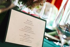 A handmade menu per table--I printed on a textured paper, glued on a green construction paper, and tied the center with a pink ribbon