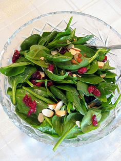Spinach Salad with Orange Balsamic Vinaigrette baby spinach dried cranberries sliced almonds, toasted Orange Vinaigrette: orange, juiced 1 tsp. honey cup extra virgin olive oil salt and pepper, to taste Spinach Salad Recipes, Veggie Recipes, Salad Bar, Soup And Salad, Healthy Snacks, Healthy Eating, Healthy Recipes, Yummy Recipes, Kitchen Recipes