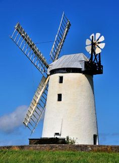 Ballycopeland Windmill: near to Millisle, Ireland - This mill with Fantail  stands a mile or so west from the small coastal village of Millisle and was built 1790, remaining in use until 1915. In 1935 it was acquired by the government of Northern Ireland and is now one of the most important and interesting historic monuments in the care of the Northern Ireland Environment Agency LinkExternal link . Fully restored (the only working example in Ireland)  A typical Irish stone tower mill.