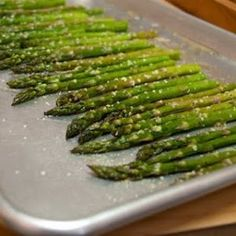 Roasted Asparagus, toss in olive oil, salt, pepper top with parmesan cheese and toss in a 400 degree oven for about 10 minutes or until tender