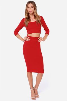 """Why choose between a sultry skirt and a curve-loving crop top, when the Rubber Ducky My Better Half Red Two-Piece Dress gives you both?! A sexy scoop neck top in crinkly stretch knit has three-quarter sleeves, and is paired with a slimming, midi-length pencil skirt. Unlined. Model is 5'9"""" and is wearing a size small. Size small top measures 14.5"""" long. Skirt measures 27"""" long. 97% Polyester, 3% Spandex. Hand Wash Cold or Dry Clean. Made with Love in the U.S.A."""