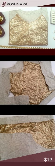 Xhilaration Oatmeal Sweatshirt w/ Gold Sequins This sweatshirt features a dazzling combination of champagne gold sequins on a heathered oatmeal cotton blend material. Original tag is missing. Adds just the right amount of sparkle to jeans for a girls night out! Xhilaration Tops Sweatshirts & Hoodies