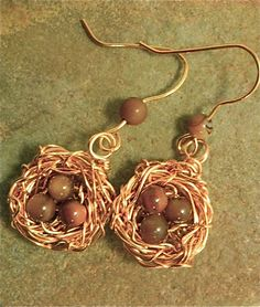 tiger's eye eggs in shiny copper nest earrings.