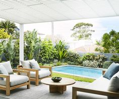 Bare backyard transformed into a contemporary coastal garden Horticulturist and designer Adam Robinson shares the clever landscaping tips he used to create a relaxed outdoor space and coastal garden for the owners of this eastern Sydney home. Residential Design, Backyard Inspo, Backyard Design, Tropical Pool Landscaping, Garden Furniture, Tropical Pool, Outdoor Living, Coastal Gardens