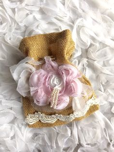 A personal favorite from my Etsy shop https://www.etsy.com/listing/234432925/wedding-money-bag-jute-pouches-burlap