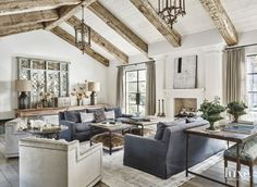 Builder Nancy Brunkhorst and project manager Brock Brunkhorst wrapped the family room's existing ceiling beams with timbers from a tobacco farm in North Carolina. Antique French chandeliers from On The Veranda illuminate A. Rudin sofas covered with Michael S. Smith's Jasper linen.