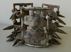 Late 18th century spiked dog collar - The iron collar has protective spikes to prevent the wearer's throat from attack by wolves and other wild animals while hunting or guarding flocks.