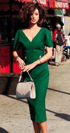 Emerald green dress - very retro style. She looks like Angelina Jolie a bit. :)