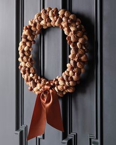 Nut wreath for fall. Really like the bronze ribbon.