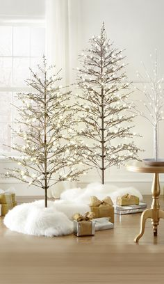 Looking for something that's a little different? Try a specialty Christmas tree this year. This artificial winterberry tree is pre-lit and features glittered branches for extra pizzazz. HomeDecorators.com #holiday2015