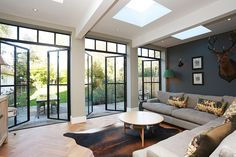 The substantial extension on this detached house features bespoke art deco style steel French doors . - The substantial extension on this detached house features bespoke art deco style steel French doors … - Crittal Doors, Crittall Windows, Estilo Art Deco, Fireplace Remodel, Kitchen Doors, Kitchen Extension French Doors, Orangery Extension Kitchen, Conservatory Extension, House Extensions