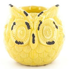 Add quirky flair and a hint of color to your office or home with this yellow ceramic owl candler holder!