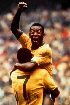 Pele celebrates with Jairzinho after scoring the first goal of the 1970 World Cup final.