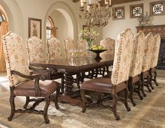 Hand Carved Dining Table Western Dining Tables - Dining table featuring a hand carved details on top apron and legs, a twisted double pedestal base and medium walnut finish. Made of mindi wood solid and veneers. Available in 96 inch width and 120 inch width.