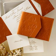 Copper Leaves Pocket - An ecru invitation card with matching ecru enclosures fit securely into the copper-colored pocket featuring an embossed leaf design. #carlsoncraft #weddinginvitation
