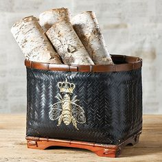 Bee Basket -- DIY? Find basket at TJ Maxx, paint with black spray paint & stencil a bee . . . or something else, in gold