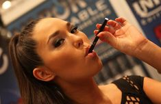 A female model demonstrating use of an electronic cigarette. Wikipedia: An electronic cigarette, or e-cigarette, is an electrical device that simulates the act of tobacco smoking by producing an inhaled vapor bearing the physical sensation, appearan Cigarettes Électroniques, Electronic Cigarettes, E Cigarette, E Liquid Flavors, Tobacco Smoking, Up In Smoke, Vape Shop, Decir No, No Worries