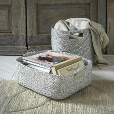 Crafted of recycled candy wrappers, these Metallic Woven Storage Baskets come in convenient sizes that fit in standard cubby holes and under the bed. A silver finish gives them girly appeal.