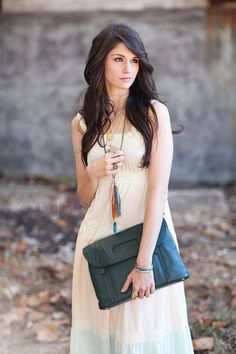 reppin the Kelly Moore bag!   beautiful white dress and the necklace makes such a difference