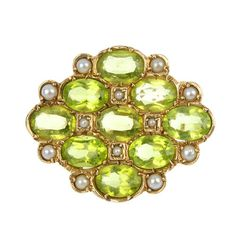 Contemporary. 9k Gold, Peridot and Seed Pearl Brooch, London, c1975.
