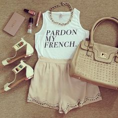 Top, shorts, bag and sandals.