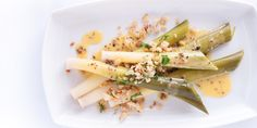 A delicious vegetarian starter recipe by Russell Brown, with tender baby leeks, crispy garlic crumb and a buttery truffle sauce.