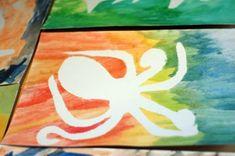 Watercolor Resist Paintings: Using contact paper sea life cutouts and watercolors!