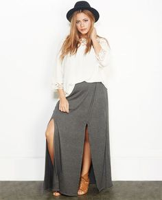 """<p>Have twice the fun in this flirty maxi skirt with two slits down either side of the front to help you show off those gorgeous gams! Skirt has a super soft stretchy knit body, a wide elasticized waistband, and a pull-on construction.</p>    <p>Model is 5'9"""" and wears a size 1X.</p>    <ul>  <li>95% Cotton / 5% Spandex</li>  <li>Hand Wash</li>  <li>USA</li>  </ul>"""