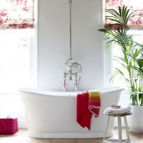 Make a statement with e free standing bath.