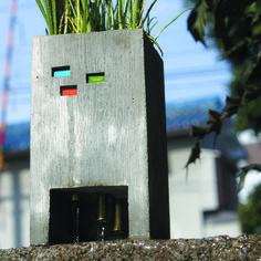 For some, a cluster of tulips in a planter on the fire escape is all the garden we want or need. Somake a statement with thiscreatively crafted cement planterby Japanese designerNobuhiro Sato. Designed to look like a building with petite glass windows,it has threeexposedwater pipesunderneath for healthy drainageandentertainmentas you water your plants.