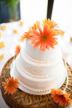 wedding cake with orange gerbera