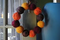 fall wreath. Love the yarn balls would add additional decoration
