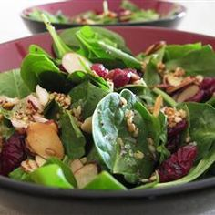 "Jamie's Cranberry Spinach Salad | ""Toss the salad as you gradually add dressing, just enough to lightly coat the greens."""