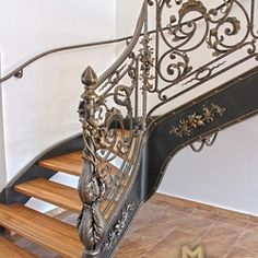 A wrought iron staircase with an exceptional interior railing Interior Railings, Interior And Exterior, Wrought Iron Staircase, Sewing Table, Blacksmithing, Antiques, Home Decor, Blacksmith Shop, Antiquities