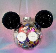 DIY Confetti Mickey Disney Ornament Need: Confetti, Styrofoam Balls, Black Paint and Glitter, Buttons, Hot Glue(Gun) Clear Ornament  What to do: Paint and Sparkle Ears. Fill ornament with confetti. Hot glue buttons and ears on! Fun and easy for everyone