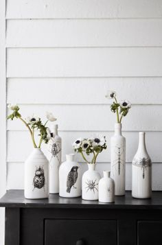 These are ceramic but I'm thinking get some old jars and bottles, paint them, then stencil, free hand, stamp, whatever...to make this look!