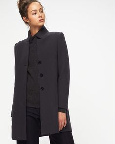 bebd17a3055 Cut for a straight fit, this herringbone coat is woven from a wool mix.