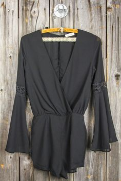 Our long sleeve romper is perfect for summer nightlife, with a sleek design, and flowy bell sleeves. · 100% Rayon · Deep V Front + Back + Long Bell Sleeves · Elastic Waistband · Extremely Soft Gauzy F