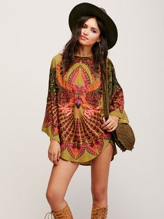 Out of This World Mini | Hand crafted in Bali, this beautifully printed oversized mini dress features dramatic wide sleeves and a rounded neck. Allover embroidery detailing adds to the prettiness of this dress.