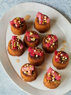 Vanilla Mini Cakes Topped with Candied Rhubarb and Pistachios http://www.spoonforkbacon.com/2018/05/vanilla-mini-cakes-topped-with-candied-rhubarb-and-pistachios/
