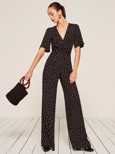 Cute outfit, easy assembly. This is a wide leg jumpsuit with a foldover shawl collar and a center front button closure.