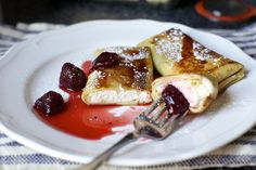 cheese blintz with loose strawberry jam