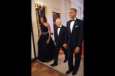 First Lady Michelle Obama (along side, Persident Barack Obama) wore a black Michael Kors one-shoulder gown for an East Room dinner with Israeli President Shimon Peres, who was presented with the Presidential Medal of Freedom. She paired the modern shift with a vintage Dior belt.